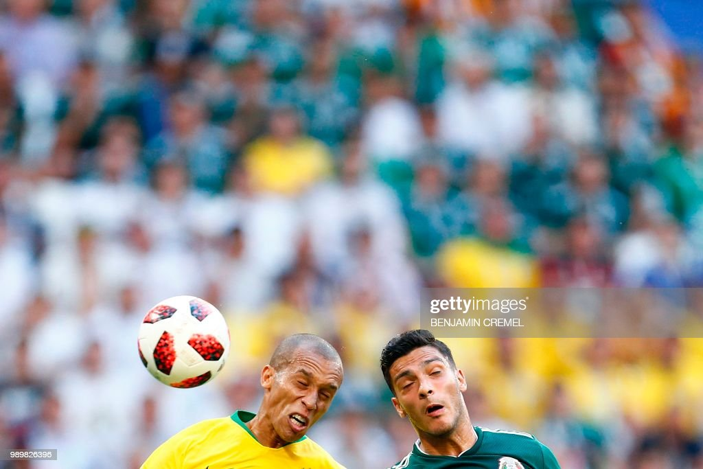 Brazil's defender Miranda (L) vies with Mexico's forward Raul Jimenez during the Russia 2018 World Cup round of 16 football match between Brazil and Mexico at the Samara Arena in Samara on July 2, 2018. (Photo by BENJAMIN CREMEL / AFP) / RESTRICTED