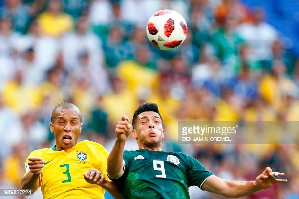 Brazil's defender Miranda vies with Mexico's forward Raul Jimenez during the Russia 2018 World Cup round of 16 football match between Brazil and...