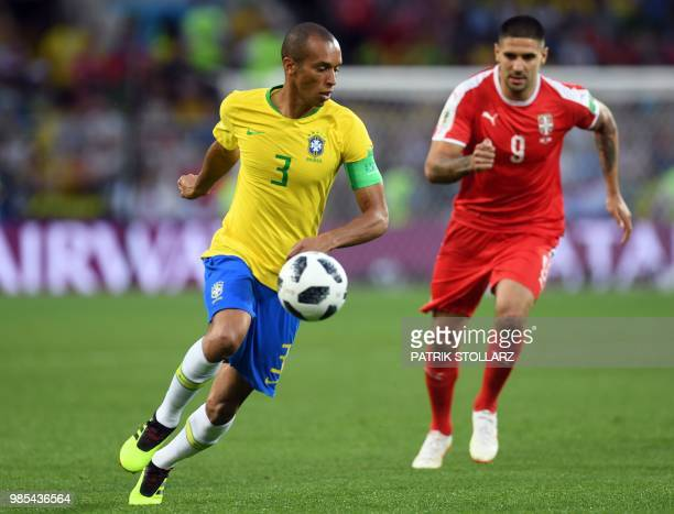 Brazil's defender Miranda vies with Serbia's forward Aleksandar Mitrovic during the Russia 2018 World Cup Group E football match between Serbia and...