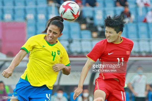 Brazil's defender Rafaelle vies for the header with China's forward Wang Shanshan during the Tokyo 2020 Olympic Games women's group F first round...