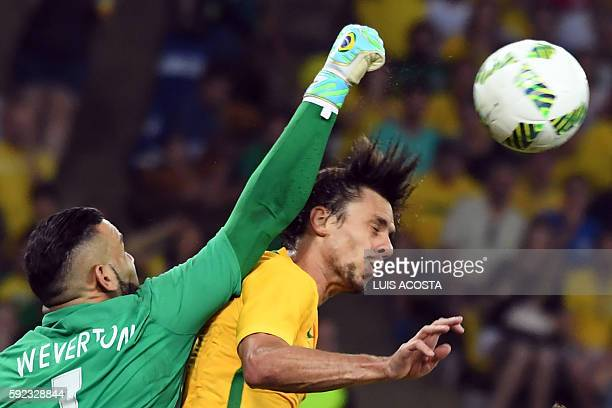 Brazil's defender Rodrigo Caio clashes with Brazil's goalkeeper Weverton Pereira da Silva during the Rio 2016 Olympic Games men's football gold medal...