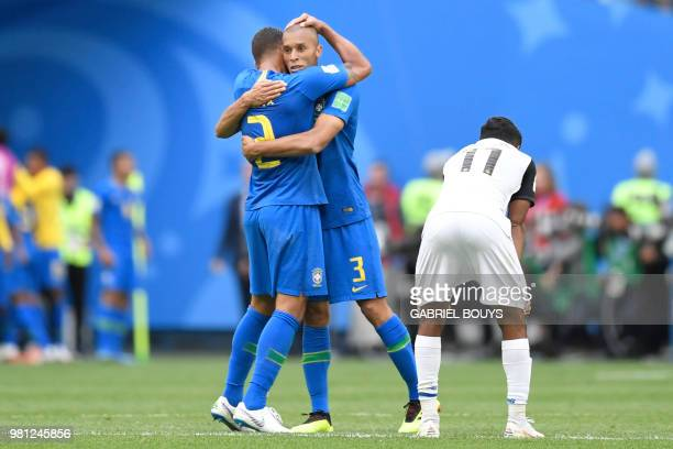 Brazil's defender Thiago Silva and Brazil's defender Miranda celebrate their team's first goal during the Russia 2018 World Cup Group E football...
