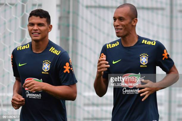 Brazil's defender Thiago Silva and Brazil's defender Miranda jog during a training session at Yug Sport Stadium in Sochi on July 4 during the Russia...