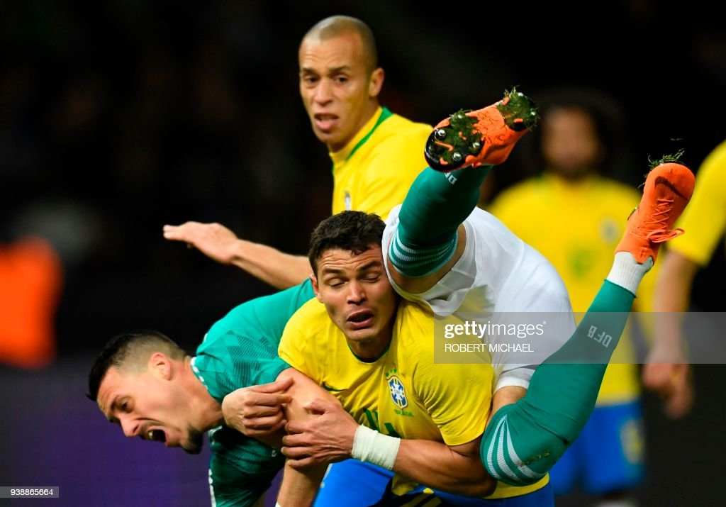 Brazil's defender Thiago Silva (front) and Germany's striker Sandro Wagner vie for the ball during their international friendly football match between Germany and Brazil in Berlin, on March 27, 2018. /