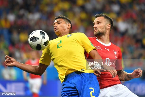 TOPSHOT Brazil's defender Thiago Silva and Switzerland's forward Haris Seferovic compete for the ball during the Russia 2018 World Cup Group E...