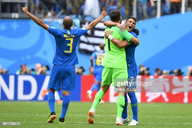 TOPSHOT Brazil's defender Thiago Silva celebrates the win with Brazil's goalkeeper Alisson and Brazil's defender Miranda during the Russia 2018 World...