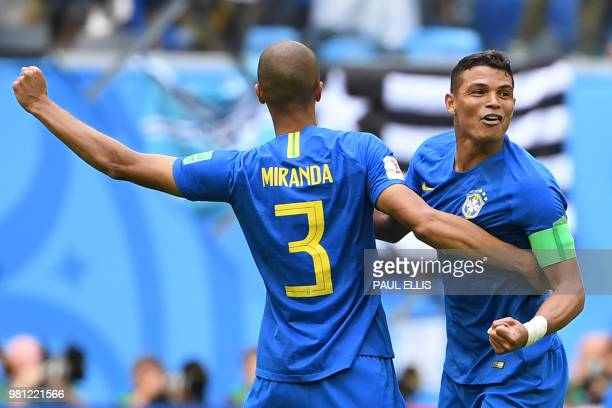 Brazil's defender Thiago Silva celebrates the win with Brazil's defender Miranda during the Russia 2018 World Cup Group E football match between...