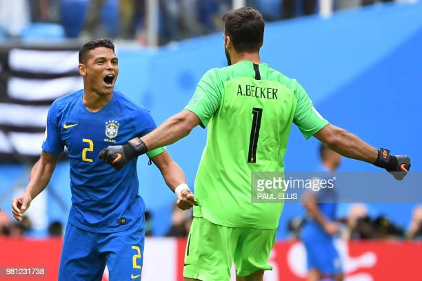 Brazil's defender Thiago Silva celebrates the win with Brazil's goalkeeper Alisson during the Russia 2018 World Cup Group E football match between...