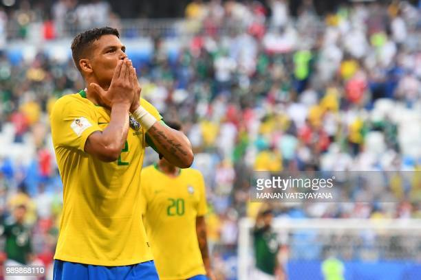 Brazil's defender Thiago Silva greets fans as he celebrates with teammates at the end of the Russia 2018 World Cup round of 16 football match between...