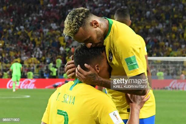 TOPSHOT Brazil's defender Thiago Silva is congratulated on his goal by Brazil's forward Neymar during the Russia 2018 World Cup Group E football...