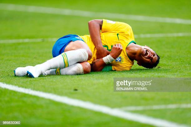 Brazil's defender Thiago Silva lies on the ground after being hit during the Russia 2018 World Cup round of 16 football match between Brazil and...