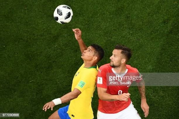 TOPSHOT Brazil's defender Thiago Silva vies with Switzerland's forward Haris Seferovic during the Russia 2018 World Cup Group E football match...