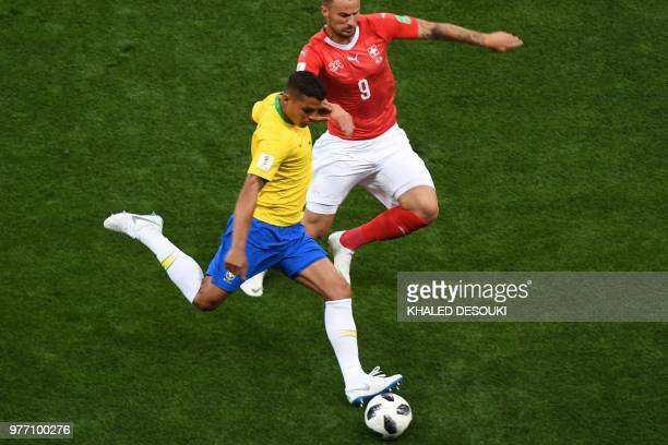 Brazil's defender Thiago Silva vies with Switzerland's forward Haris Seferovic during the Russia 2018 World Cup Group E football match between Brazil...