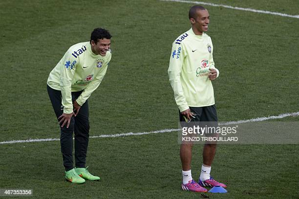 Brazil's defenders Thiago Silva and Miranda take part in a training session of Brazil's national football team on March 23 2015 at the Charlety...