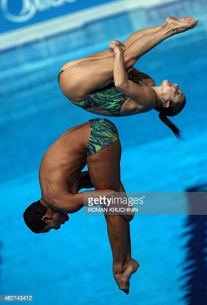 Brazil's divers Ian Matos and Juliana Veloso compete in the Mixed 3m Synchronised Springboard final diving event at the 2015 FINA World Championships...