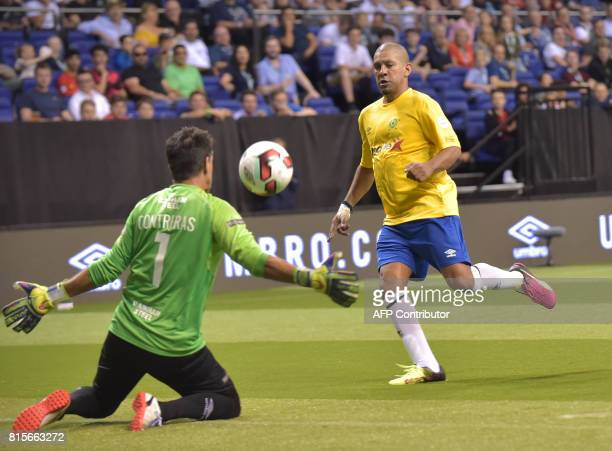 Brazil's Djalminha scores during the Star Sixes 3rd place playoff football match between Spain and Brazil at the O2 Arena in London on July 16 won by...