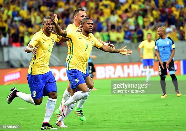 Brazil's Douglas Costa celebrates after scoring against Uruguay during their Russia 2018 FIFA World Cup South American Qualifiers' football match in...
