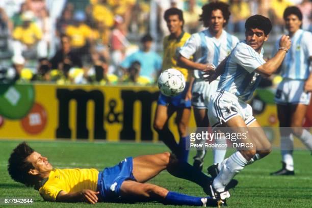 Brazil's Dunga slide tackles Argentina's Diego Maradona