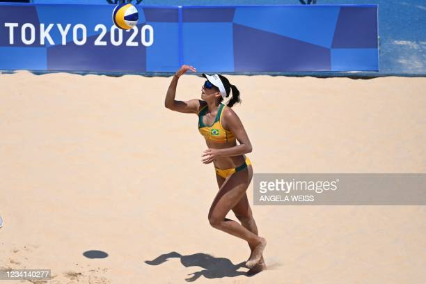 Brazil's Eduarda Santos Lisboa prepares to serve in their women's preliminary beach volleyball pool C match between Brazil and Argentina during the...