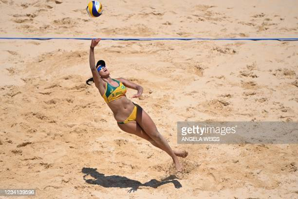 Brazil's Eduarda Santos Lisboa reaches for the ball in their women's preliminary beach volleyball pool C match between Brazil and Argentina during...