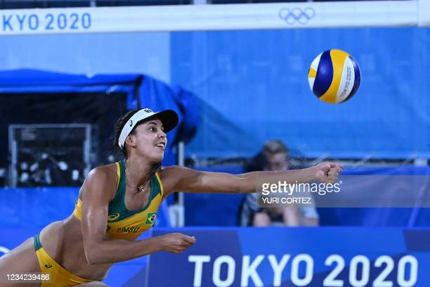 Brazil's Eduarda Santos Lisboa reaches fot the ball in their women's preliminary beach volleyball pool C match between Brazil and China during the...