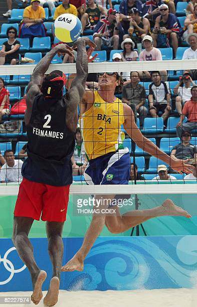 Brazil's Emanuel Rego smashes a ball to Angola's Morais during the Men's preliminary Beach Volleyball match at Beijing's Chaoyang Park Beach...