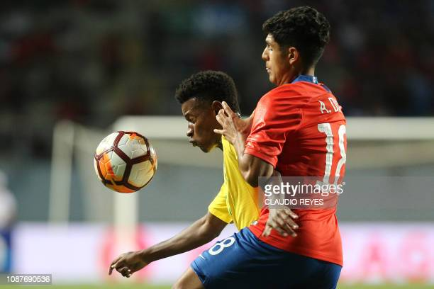 Brazil's Eric Dos Santo vies for the ball with Chile's Antonio Diaz during their South American U20 football match at El Teniente stadium in Rancagua...