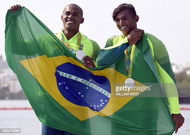 TOPSHOT Brazil's Erlon De Souza Silva and Brazil's Isaquias Queiroz Dos Santos celebrate on the podium of the Men's Canoe Double 1000m final at the...