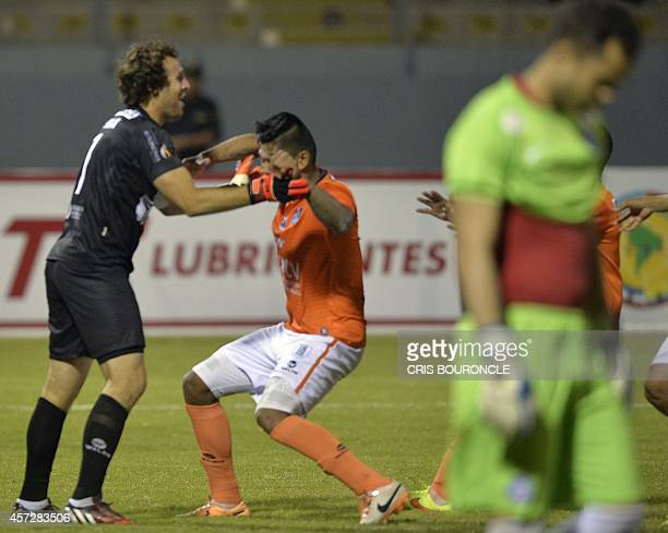 Brazils Esporte Clube Bahia goalkeeper Marcelo Lomba walks away in dejection as Perús Cesar Vallejo goalkeeper Salomon Lipman celebrates his goal...