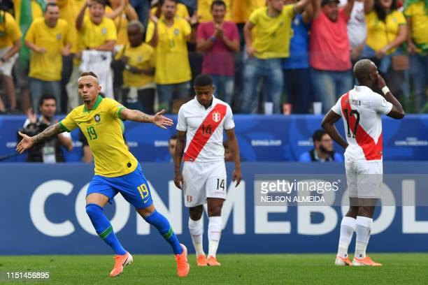 Brazil's Everton celebrates after scoring against Peru during their Copa America football tournament group match at the Corinthians Arena in Sao...