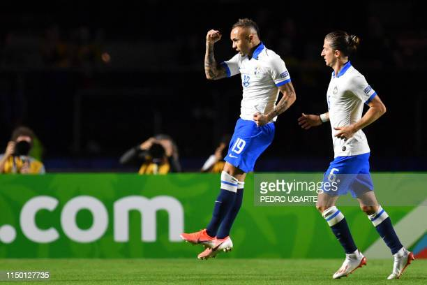 Brazil's Everton celebrates next to teammate Filipe Luis after scoring against Bolivia during their Copa America football tournament group match at...