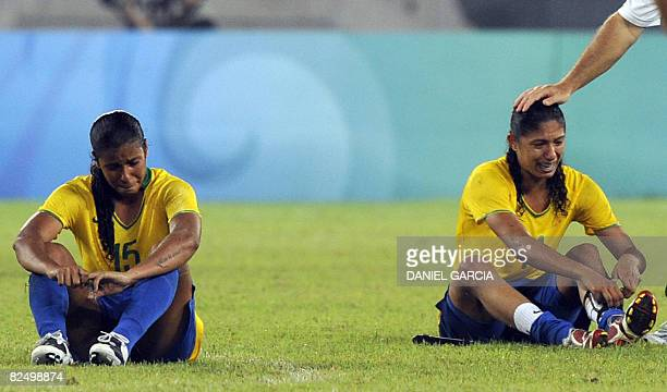 Brazil's Fabiana and Cristiane react after losing 01 to US in extra time in the women's football gold medal match in the 2008 Beijing Olympic Games...