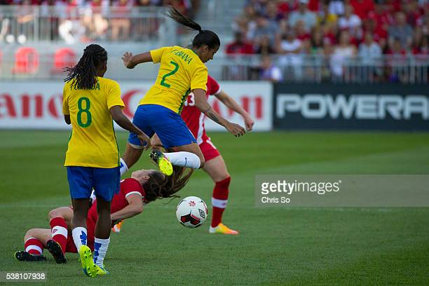 TORONTO ON JUNE 4 2016 Brazil's Fabiana knocks down Canada's Allysha Chapman with her left knee during the first half of play at BMO Field Canadas...