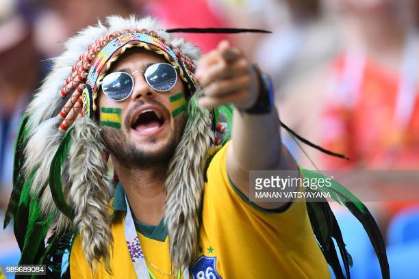 Brazil's fan cheers prior to the Russia 2018 World Cup round of 16 football match between Brazil and Mexico at the Samara Arena in Samara on July 2,...