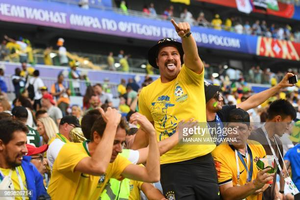 Brazil's fans celebrate at the end of the Russia 2018 World Cup round of 16 football match between Brazil and Mexico at the Samara Arena in Samara on...