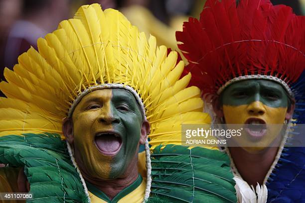 Brazil's fans cheer prior to the Group A football match between Cameroon and Brazil at the Mane Garrincha National Stadium in Brasilia during the...