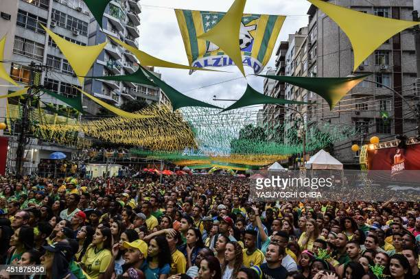Brazil's fans react during a public viewing event at a street in Rio de Janeiro during the 2014 FIFA World Cup semifinal match Brazil vs Germany...