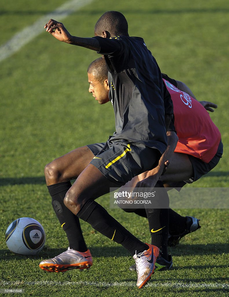 Brazil's Felipe Melo and Michel (behind) fight for the ball during a team training session at Randburg High School on June 5, 2010 in Johannesburg. The team is preparing to compete in the 2010 World Cup football tournament in South Africa.