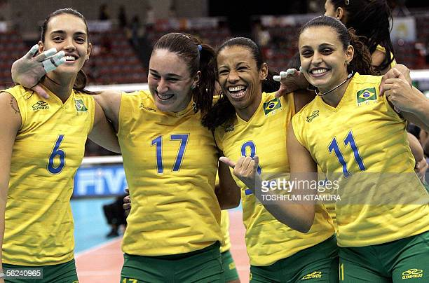 Brazil's Fernanda Alves Renata Colombo captain Valeska Menezes and Marcelle Moraes celebrate after winning the 2005 World Grand Champion Cup women's...