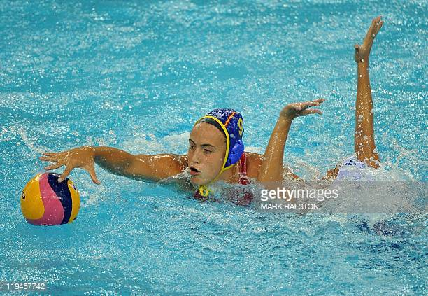 Brazil's Fernanda Lissoni and Spain's Helena Lloret Gomez compete during their women's group C water polo preliminary round match in the FINA World...