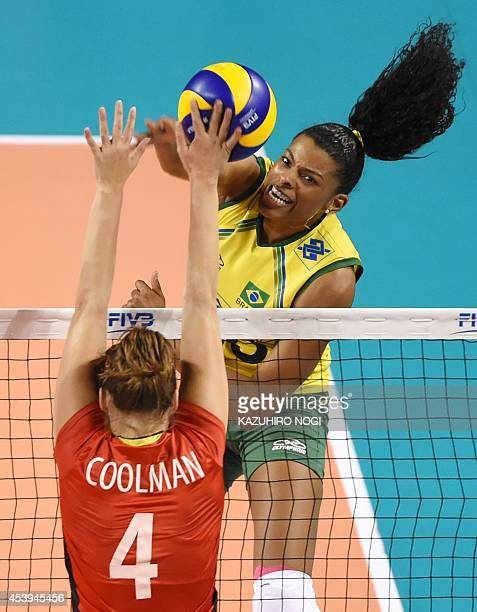 Brazil's Fernanda Rodrigues attacks against Belgium's Nina Coolman during their volleyball match of the FIVB Women's World Grand Prix finals in Tokyo...