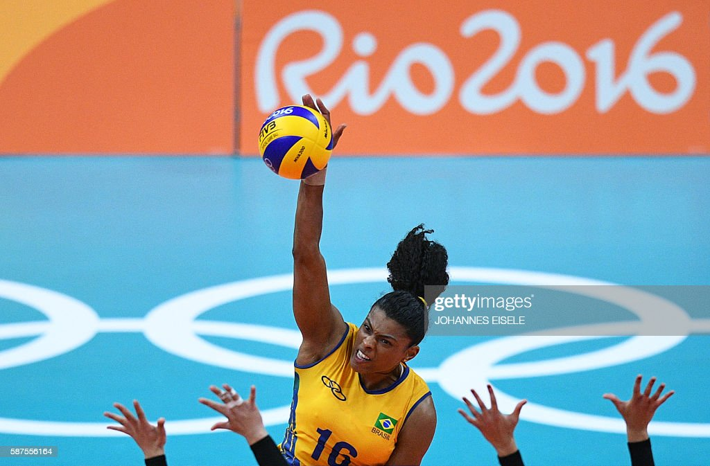 TOPSHOT - Brazil's Fernanda Rodrigues spikes the ballduring the women's qualifying volleyball match between Brazil and Argentina at the Maracanazinho stadium in Rio de Janeiro on August 8, 2016, during the 2016 Rio Olympics. / AFP / Johannes EISELE
