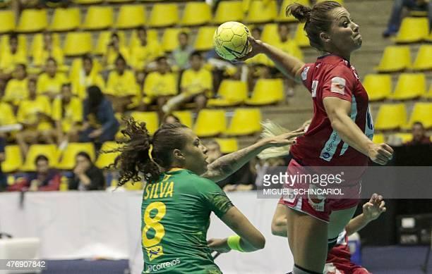 Brazil's Fernanda Silva is marked by Norwegian Mork during the women handball match between world champions and Olympic champions in Sao Bernardo do...