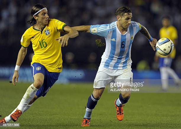 Brazil's Filipe Luis and Argentina's Lucas Biglia vie for the ball during their Russia 2018 FIFA World Cup South American Qualifiers football match...