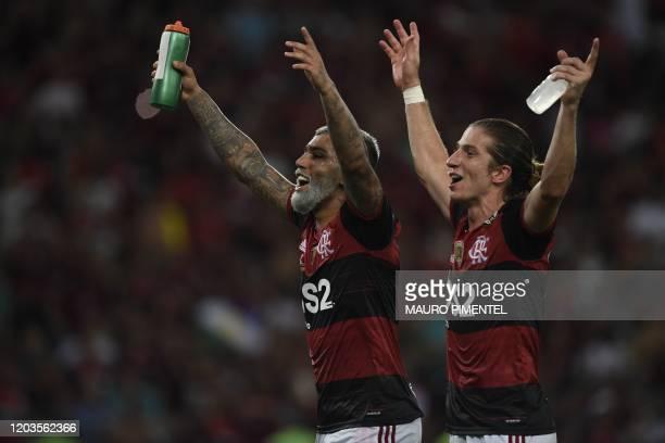 Brazil's Flamengo defender Filipe Luis and forward Gabriel Barbosa celebrate after winning their Recopa Sudamericana 2020 final football match...