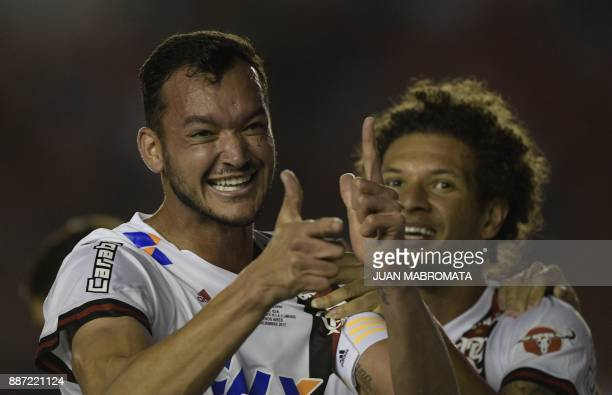 Brazil's Flamengo defender Rever celebrates with teamamte midfielder Willian Arao after scoring a goal against Argentina's Independiente during the...