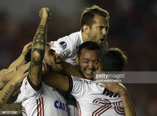 Brazil's Flamengo defender Rever celebrates with teammates after scoring a goal against Argentina's Independiente during the Copa Sudamericana first...