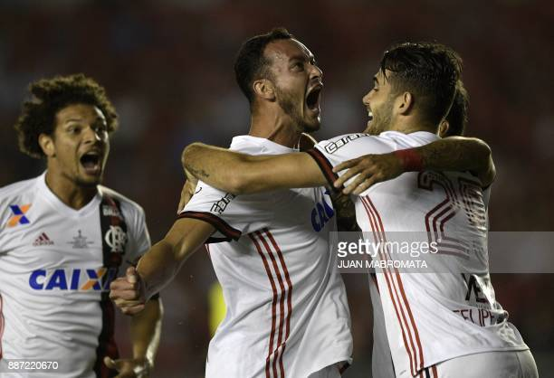 TOPSHOT Brazil's Flamengo defender Rever celebrates with teammates forward Felipe Vizeu and midfielder Willian Arao after scoring against Argentina's...