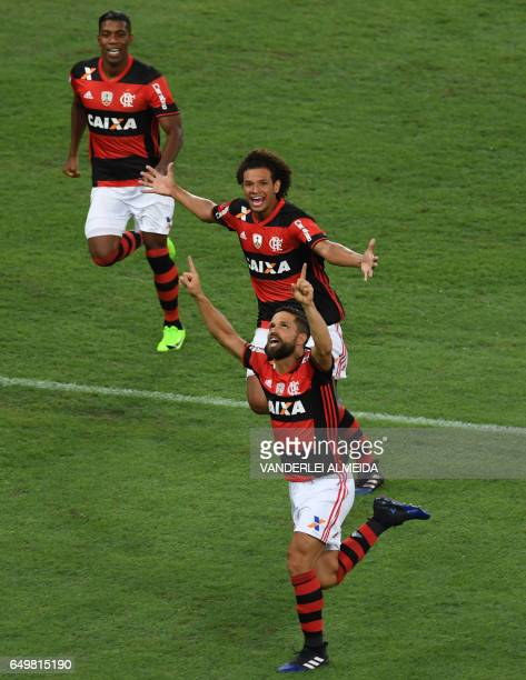 Brazil's Flamengo Diego Ribas celebrates with teammates after scoring against Argentina's San Lorenzo during their Libertadores Cup football match at...