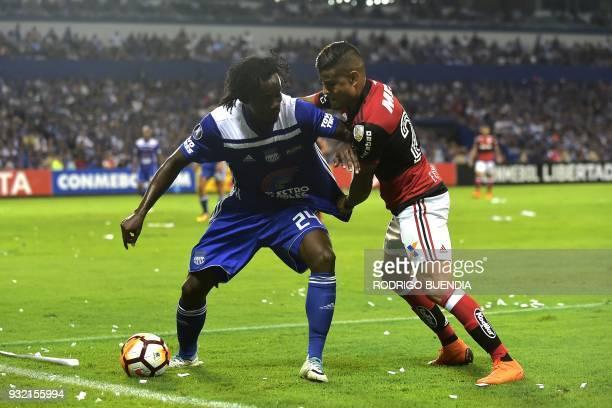 Brazil´s Flamengo Everton vies for the ball with Ecuador´s Emelec Juan Paredes during their Copa Libertadores 2018 football match at George Capwell...
